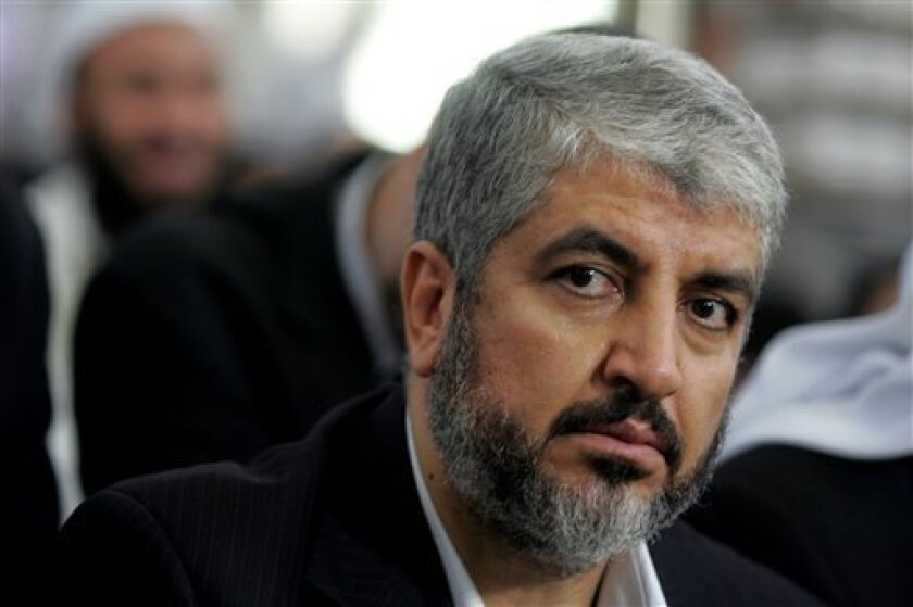 FILE - In this this Aug. 29, 2009 file photo, Khaled Mashaal, Hamas leader, center, attends his father's funeral at a Mosque in Amman, Jordan. Senior Hamas figures gathered for the last stage of internal elections on Monday in Cairo, where two officials in the Islamic militant movement said a new leader may be announced later in the day. Qatar-based Mashaal, who has run the Palestinian movement since 1996, is seen as the front-runner. Mashaal, 56, is backed by regional powers Qatar, Turkey and E