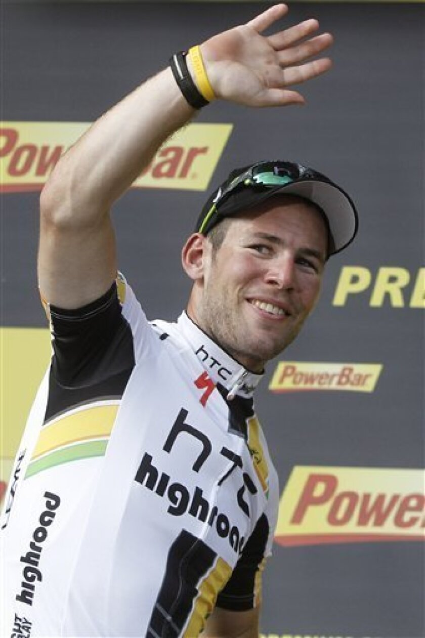 Stage winner Mark Cavendish of Britain celebrates on the podium of the seventh stage of the Tour de France cycling race over 218 kilometers (135.5 miles) starting in Le Mans and finishing in Chateauroux, central France, Friday July 8, 2011. (AP Photo/Laurent Cipriani)