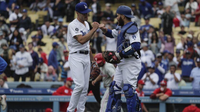 LOS ANGELES, CA, SUNDAY, JUNE 2, 2019 - Dodgers catcher Russell Martin congratulates Joe Kelly after