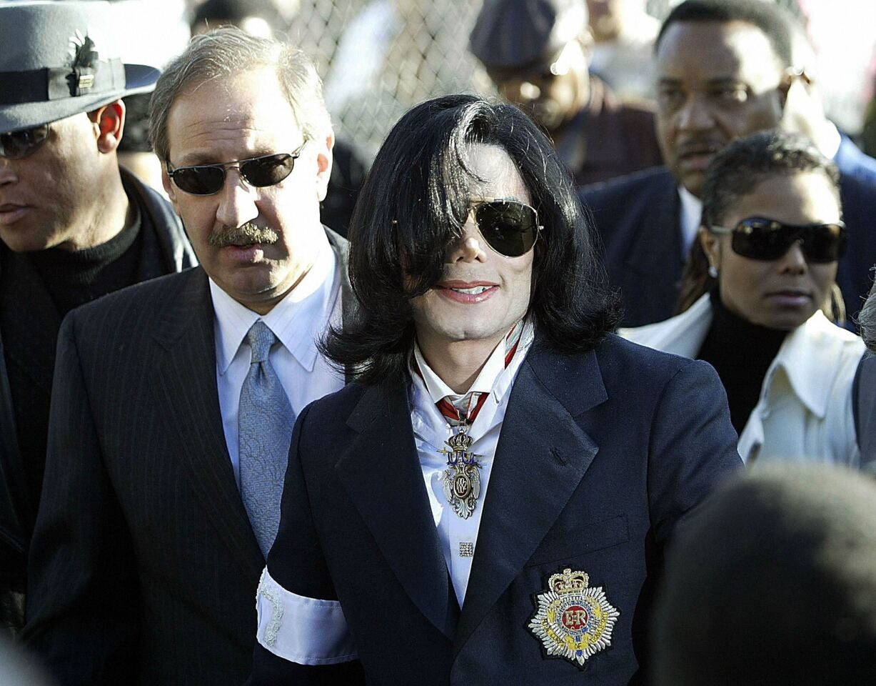 Mark Geragos, left, Michael Jackson and his sister Janet Jackson arrive for the King of Pop's arraignment on child molestation charges at the courthouse in Santa Maria, Calif., in January 2004.