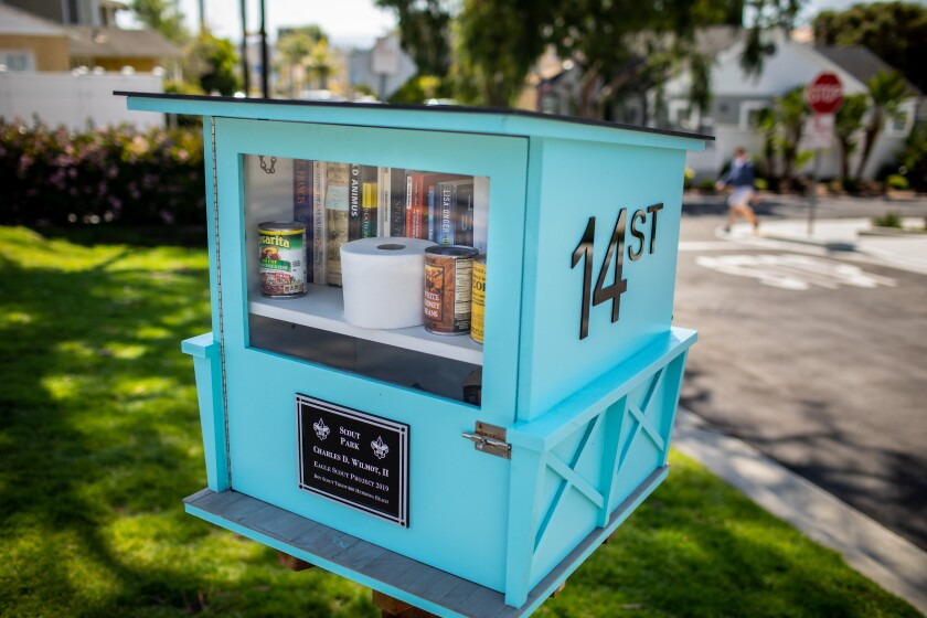 A lending library included some additional useful items, including a roll of toilet paper and cans of beans and corn, in a Hermosa Beach neighborhood on Sunday.