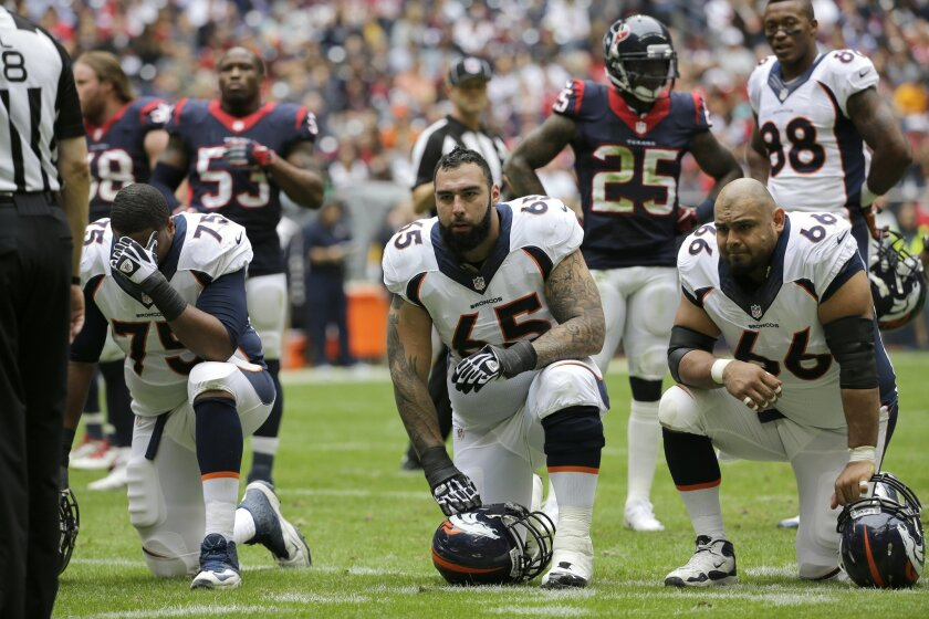 FILE - In this Dec. 22, 2013 file photo, Denver Broncos guard Louis Vasquez (65) and Manny Ramirez (66) kneel after a player injury during the first quarter of an NFL football game against the Houston Texans, in Houston. (AP Photo/David J. Phillip, File)