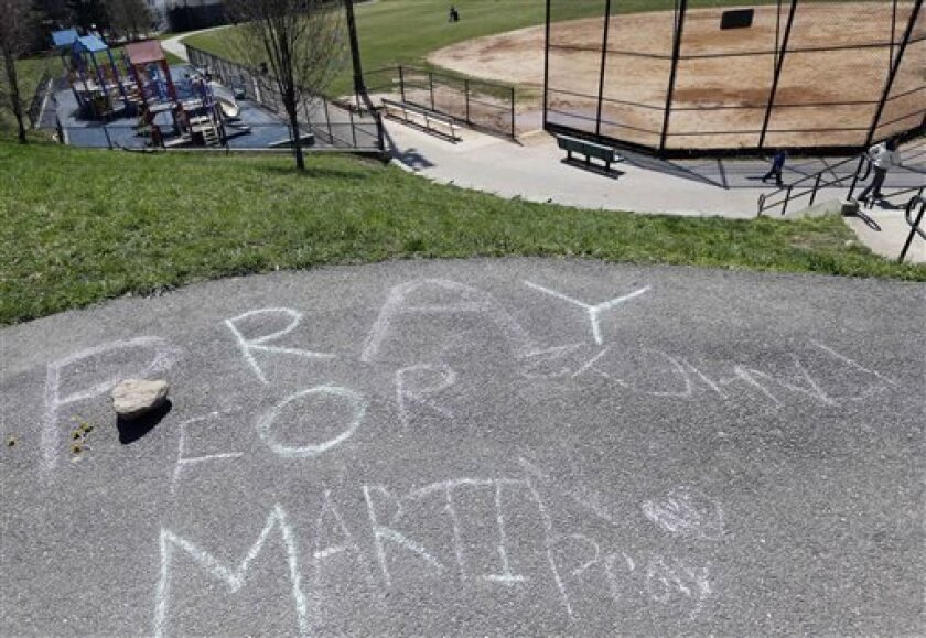 Pray for Martin is written in chalk at a park near the home of Martin Richard in the Dorchester neighborhood of Boston,Tuesday, April 16, 2013. 8-year old Martin was killed in the bombing at the finish line of the Boston Marathon on Monday. (AP Photo/Michael Dwyer)