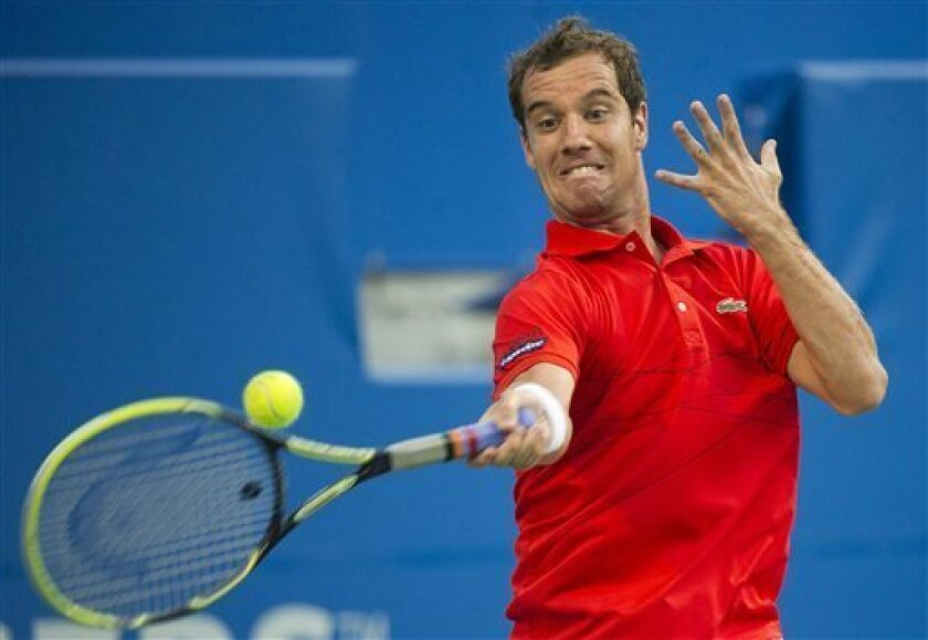 Richard Gasquet of France returns the ball against Mardy Fish the United States during 2012 Rogers Cup tennis action in Toronto on Friday, Aug. 10, 2012. (AP Photo/The Canadian Press, Nathan Denette)