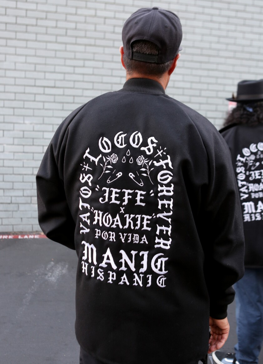 "Gilbert de Manic Hispanic ""Dreamer"" Pichardo wears a jacket commemorating Gabby ""Jefe"" Gaborno and Steve ""Hoakie"" In a way to."