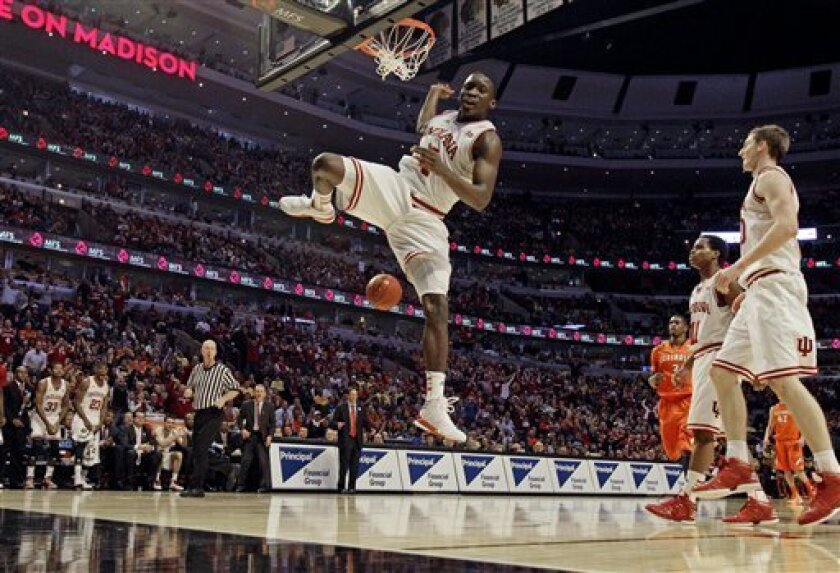Indiana's Victor Oladipo dunks during the second half of an NCAA college basketball game at the Big Ten tournament against Illinois Friday, March 15, 2013, in Chicago. Indiana won 80-64. (AP Photo/Nam Y. Huh)