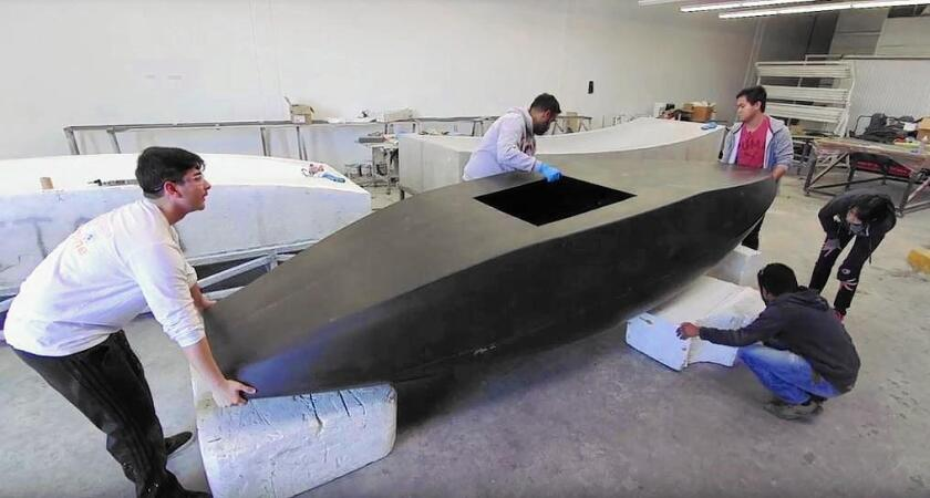 UC Irvine students on the HyperXite team work on their creation for Sunday's SpaceX Hyperloop Pod Competition at SpaceX headquarters in Hawthorne. The competition aims to speed up the development of a prototype for a high-speed ground transportation system.