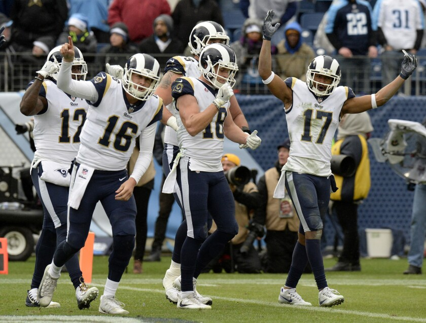 FILE - In this Dec. 24, 2017, file photo, Los Angeles Rams quarterback Jared Goff (16) and celebrates with wide receiver Cooper Kupp (18) after Kupp scored a touchdown against the Tennessee Titans in the second half of an NFL football game in Nashville, Tenn. The Rams, who are in the playoffs for the first time since 2004, host the Falcons on Saturday in the showcase of wild-card weekend.