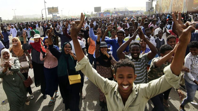 Tens of thousands of Sudanese make their way to the center of the country's capital, Khartoum, cheering the removal of longtime autocratic President Omar Hassan Ahmed Bashir.