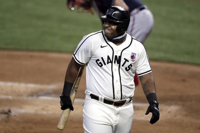 Miami Marlins' Jesus Aguilar reacts after striking out during the fifth inning of a baseball game against the Atlanta Braves, Sunday, Aug. 16, 2020, in Miami. (AP Photo/Lynne Sladky)