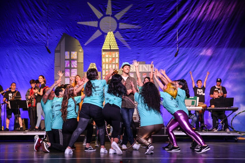"""Jason Mraz with performers from transcenDANCE, Banding Together and other groups in a number from """"Shine."""""""