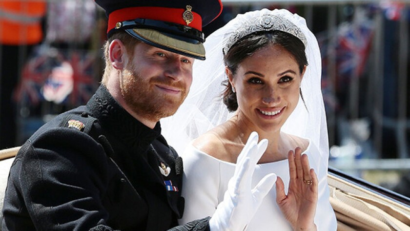 Britain's Prince Harry, Duke of Sussex and his wife Meghan, Duchess of Sussex.