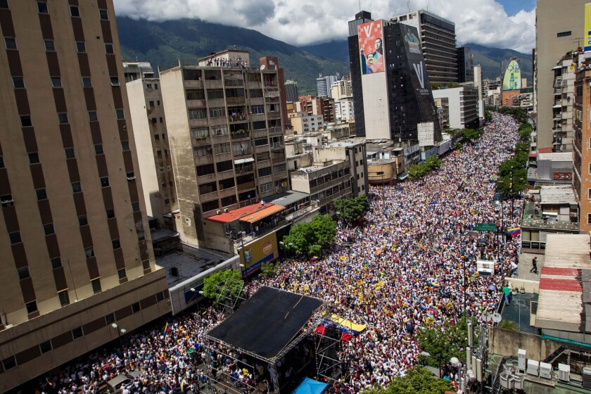 Thousands of people participate in a demonstration in Caracas on Thursday.