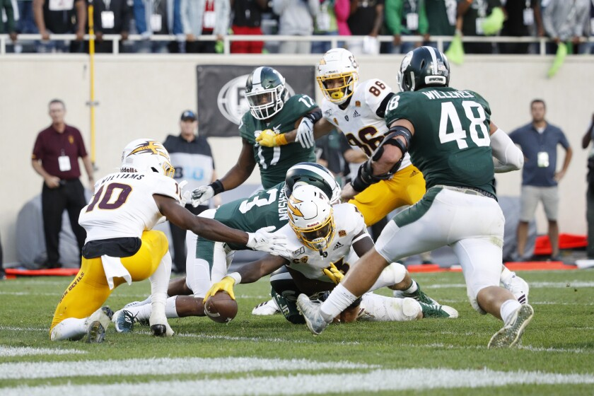 Arizona State's Eno Benjamin scores in his team's 10-7 win at No. 18 Michigan State on Sept. 14, 2019.
