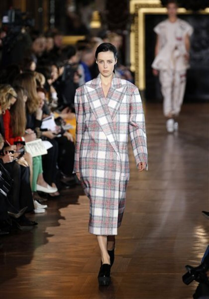 A model wears a creation by fashion designer Stella McCartney for her Fall/Winter 2013-2014 ready to wear collection, in Paris, Monday, March, 4, 2013. (AP Photo/Christophe Ena).
