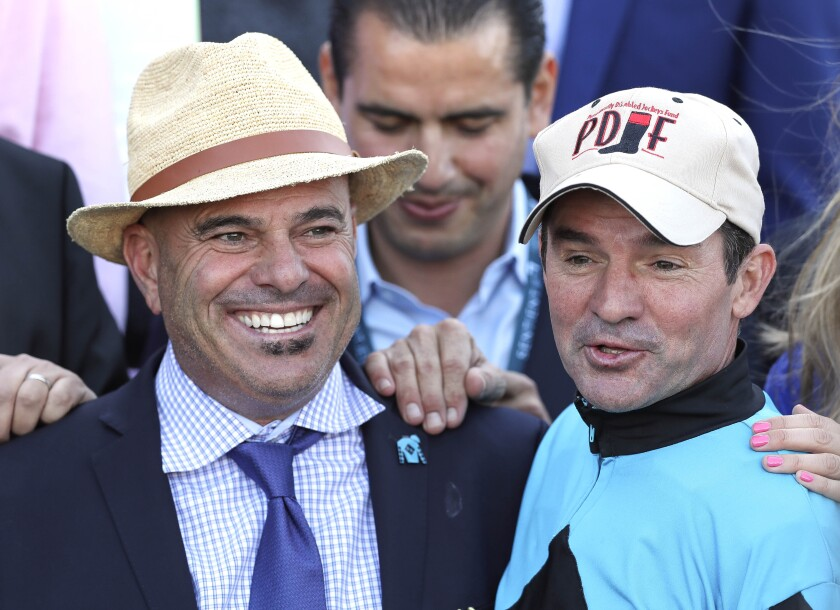 Trainer Peter Miller, shown at left after winning the Breeders' Cup Sprint in 2017 at Del Mar with Roy H, is hunting for wins on racing's richest weekend for the third year in a row.