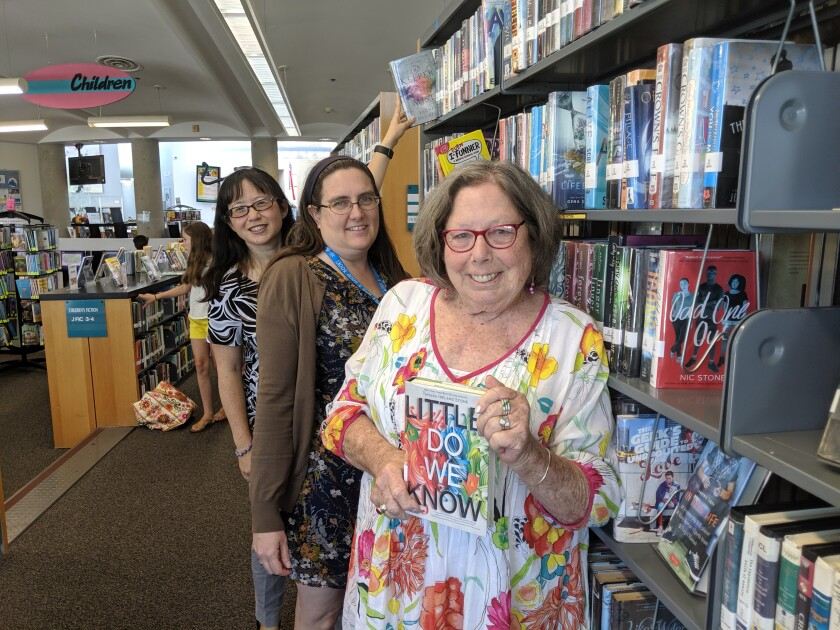 Branch Manager Christina Wainwright, Youth Services Librarian Rebecca Smith, and Friends of the PB Library President Connie Mason