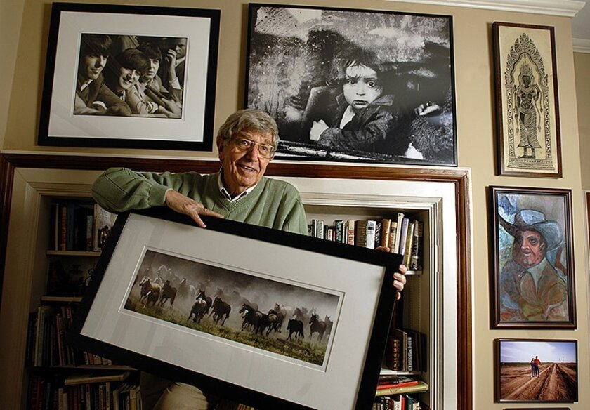 In this Sept. 11, 2006 photo, Bill Snead poses for a photo at home in Lawrence, Kan. Snead, an award-winning news photographer from Kansas whose career included covering wars and national political conventions, has died. Snead's wife, Dona Snead, said Monday, Feb. 15, 2016, that Snead died at his L