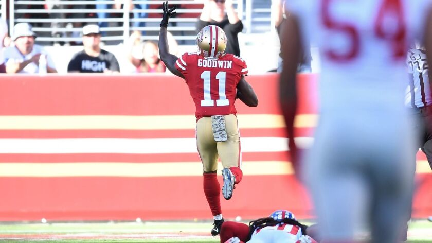 San Francisco receiver Marquise Goodwin scores on an 83-yard reception against the New York Giants on Nov. 12.