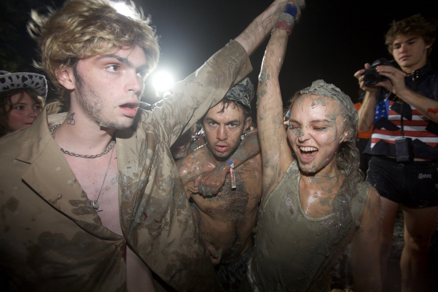 Lily-Rose Deppm, right, celebrates Aug. 3 at the Great American Mud Wrestle event in Sun Valley.
