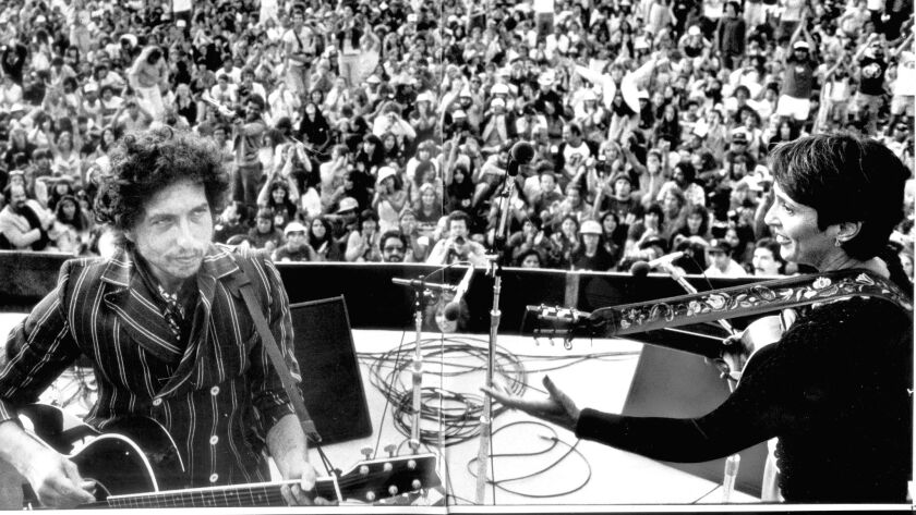 Bob Dylan and Joan Baez at the Rose Bowl in 1982.