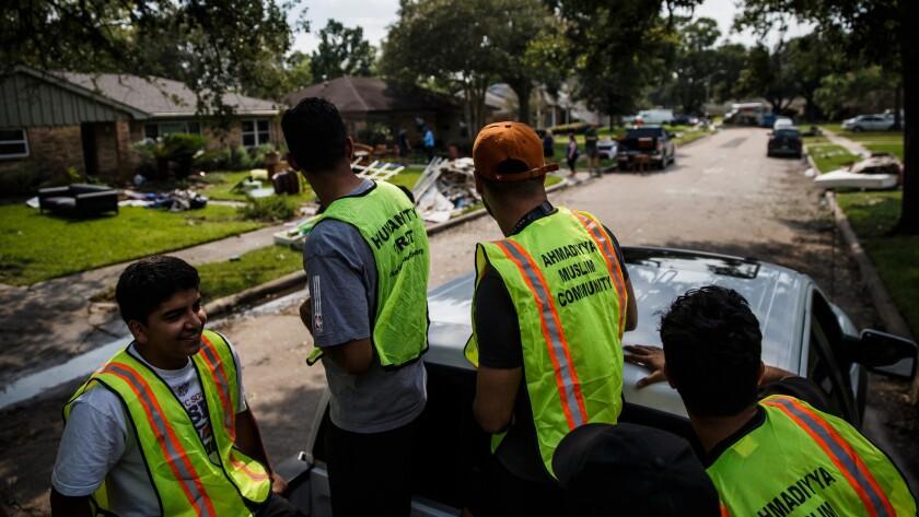 Volunteers from the Ahmadiyya Muslim Youth Assn. arrive in the Westbury neighborhood to help residen