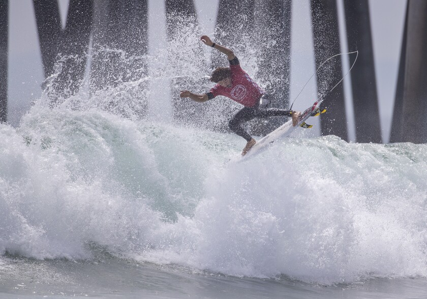 Yago Dora does an aerial during the Vans US Open of Surfing men's final at Huntington Beach on Sunday.