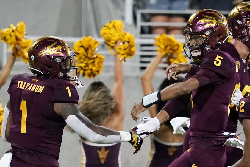 Arizona State quarterback Jayden Daniels (5) celebrates his touchdown run against Stanford with running back DeaMonte Trayanum (1) during the first half of an NCAA college football game Friday, Oct. 8, 2021, in Tempe, Ariz. (AP Photo/Ross D. Franklin)