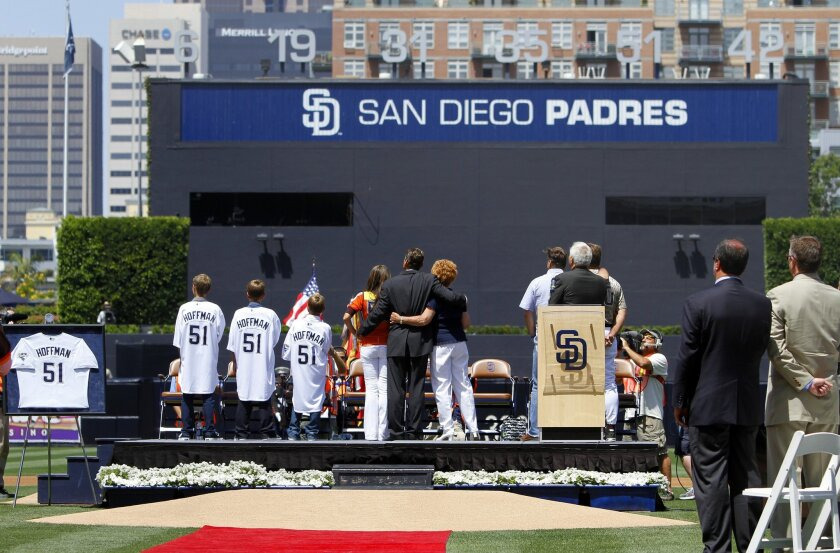 Former padres pitcher Trevor Hoffman with his family, wife Tracy, mom Mikki, right, and sons  Brody, Quinn, and Wyatt, watch as his late father Ed sings the national anthem on the video board.