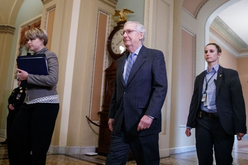 Senate Majority Leader Mitch McConnell walks to the Senate floor before the vote on calling witnesses on Jan. 21.