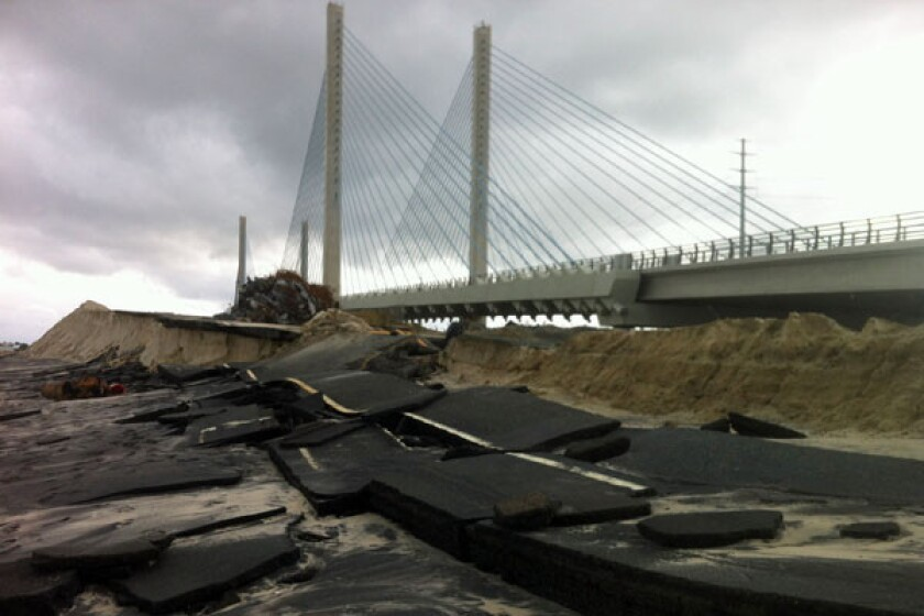 Sandy smashes road to old Delaware bridge, spares new one