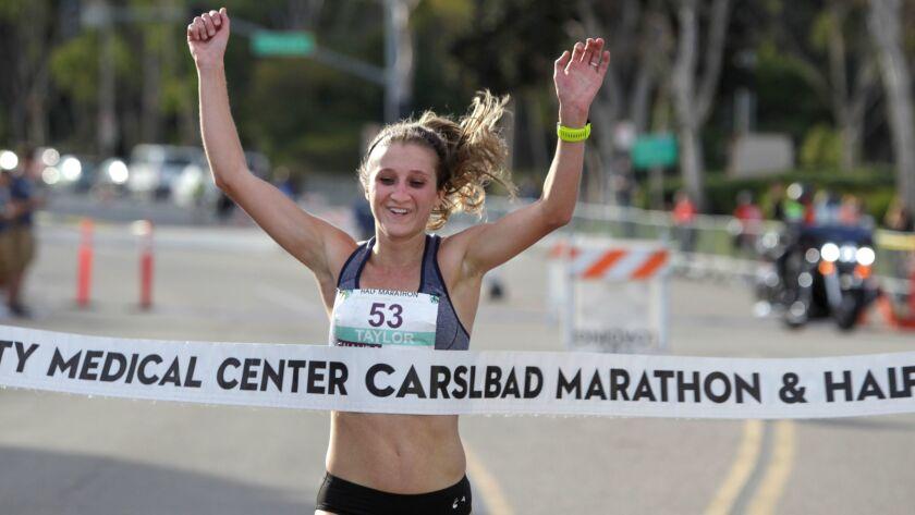 Taylor Ward of Ogden, Utah, wins the women's race in the Carlsbad Half Marathon.
