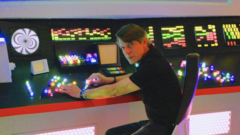 """Adam Nimoy said because of all the time he spent on the """"Star Trek"""" set as a boy, he felt right at home in a mockup of the Enterprise at a Las Vegas convention."""