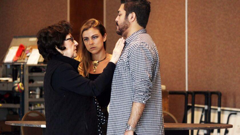 Director Marta Domingo instructs soprano Corinne Winters and tenor Jesus Garcia during rehearsals fo