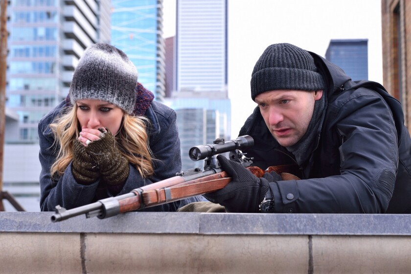 """Dutch Velders (Ruta Gedmintas) and Ephraim Goodweather (Corey Stoll) set up their sniper attack in """"The Assassin"""" episode of """"The Strain."""""""
