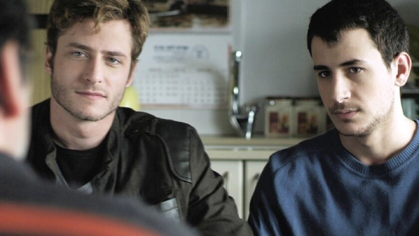 "Michael Aloni, left, and Nicholas star in ""Out in the Dark."""