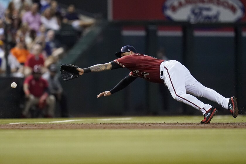 Arizona Diamondbacks third baseman Asdrubal Cabrera is unable to make a play on a double hit by San Francisco Giants' Curt Casali during the third inning of a baseball game Saturday, July 3, 2021, in Phoenix. (AP Photo/Ross D. Franklin)