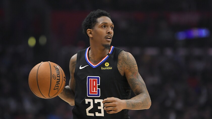 Clippers guard Lou Williams brings the ball up court during a game.