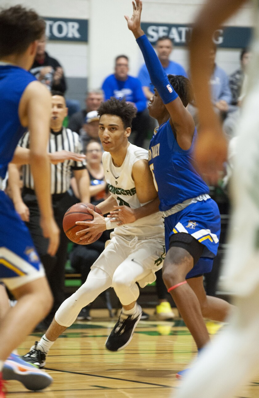 Providence's Jordan Shelley moves the ball past Fountain Valley's Jermiah Davis during CIF State Division III Southern California Regional semifinal at Providence High. (Photo by Miguel Vasconcellos)