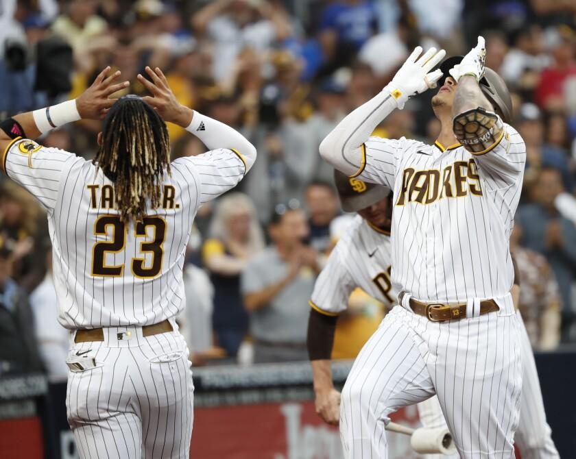 Manny Machado and Fernando Tatis Jr. celebrate after Machado hit a home run against the Dodgers on June 23.