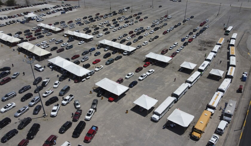 People in buses and cars wait to be vaccinated with the COVID-19 Pfizer vaccine at the parking lot of the Benito Juarez Olympic Stadium in Ciudad Juarez, Mexico, Wednesday, May 26, 2021. (AP Photo/Christian Chavez)
