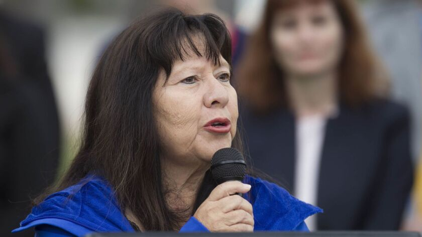 National City Councilwoman Mona Rios speaks at a rally in 2017.