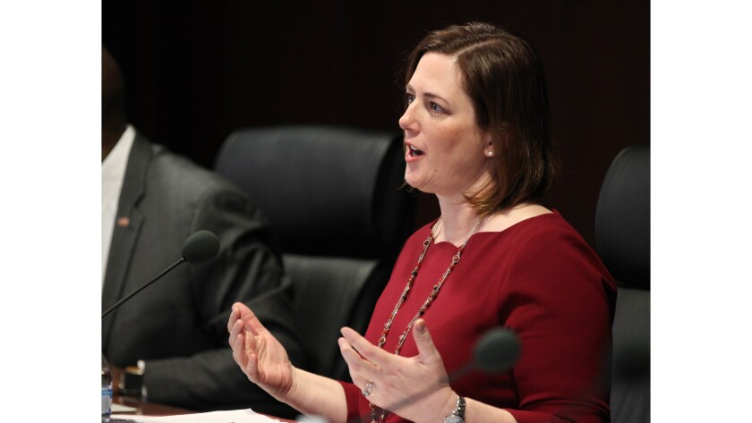 Gaming Control Board chairwoman Becky Harris asks a question of Alex Meruelo who was requisition a g