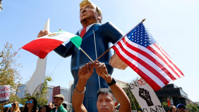 Marchers carry an effigy of Donald Trump at last year's May Day march in downtown Los Angeles.