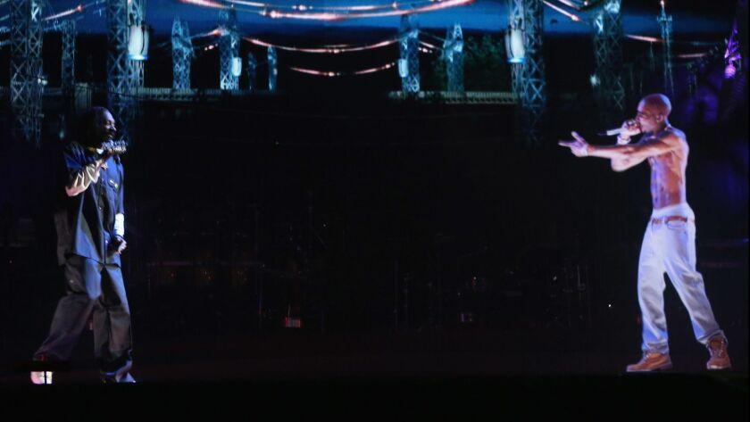 Rapper Snoop Dogg and a hologram-like image of Tupac Shakur at Coachella.