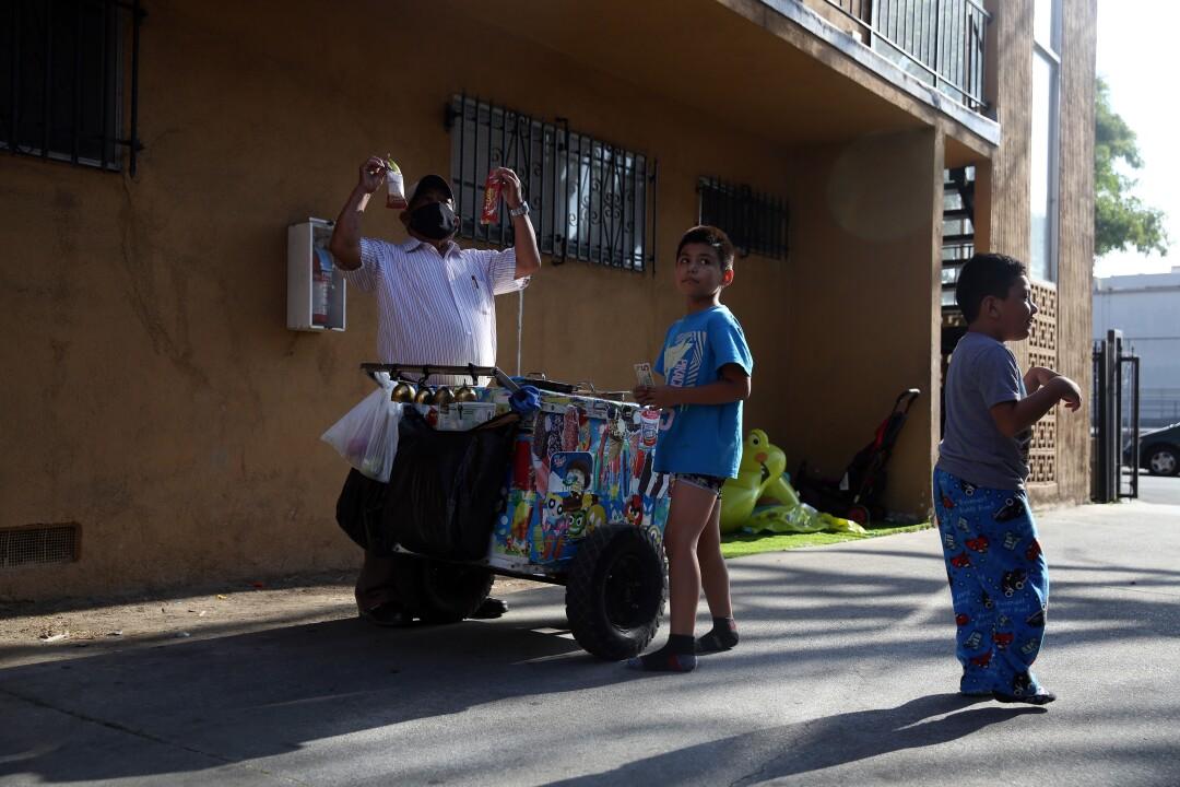 Rios sells paletas to children in an apartment complex.