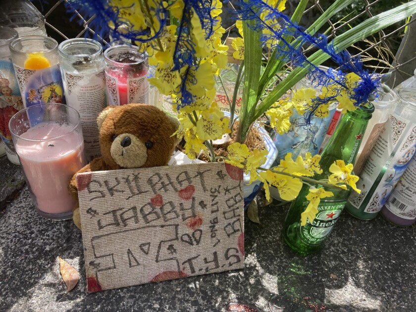 FILE - In this April 28, 2021, file photo, a stuffed bear sits with other tributes at a street memorial where Honolulu Police shot and killed 16-year-old Iremamber Sykap, whose nickname was Baby, during a car chase on Kalakaua Ave., in Honolulu. Grand jurors have declined to indict three Honolulu police officers in a shooting that killed a 16-year-old boy. The Honolulu prosecuting attorney's office said it presented evidence to a grand jury Wednesday, June 9, 2021 seeking indictments of the three officers. The grand jury declined to return indictments for any of the officers in the April 5 shooting that killed Iremamber Sykap, it said. (AP Photo/Jennifer Sinco Kelleher, File)