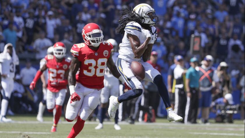 After beating Chiefs safety Ron Parker downfield, Chargers receiver Travis Benjamin drops a long pass from quarterback Philip Rivers in the fourth quarter Sunday.