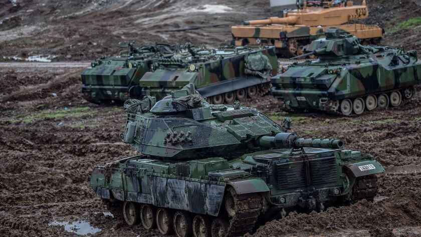 """Turkish army tanks are stationed in a field near the Syrian border at Hassa, in Hatay province, on Jan. 25, 2018, as part of a military offensive dubbed """"Operation Olive Branch."""""""
