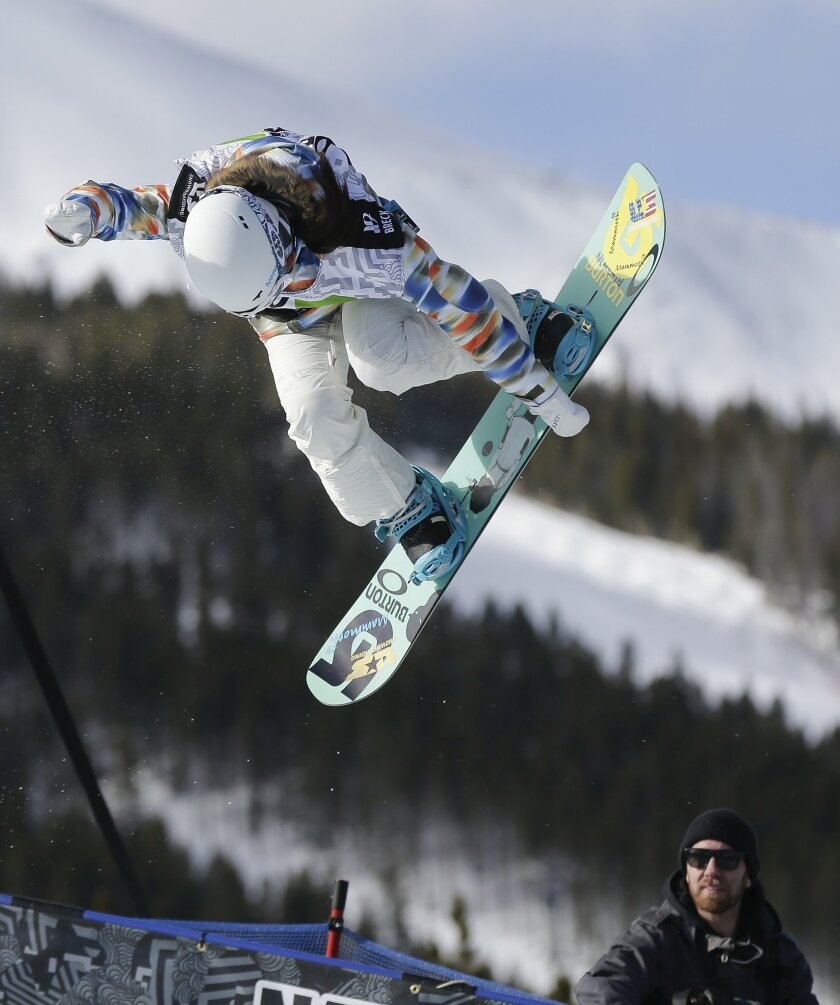 FILE - In this Dec. 14, 2013, file photo, Chloe Kim competes during the women's snowboarding superpipe final at the Dew Tour iON Mountain Championships in Breckenridge, Colo. One of the best snowboarders in the world was too young to go to the Sochi Olympics a year ago. So teenager Chloe Kim watche